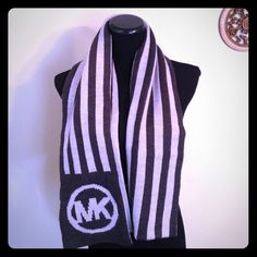 OGO 50% NWT, Michael Kors striped logo scarf Absolutely stunning Michael Coors excess three this is a match all where all every day long and beautiful knit scarf you can do so many things with the scarf because of the length and the width! The scarf in particular is one size fits all the style number is 535429 DER. Retails $98. Tag attached! Great for a gift if you can part from it! The MK logo is absolutely stunning this scarf is very classy 100% acrylic. Hand wash or machine wash cold hang…