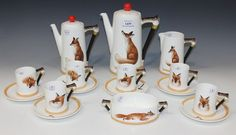 Lot 1439 - A Royal Doulton Reynard the Fox pattern part coffee service, comprising coffee pot and cover, hot
