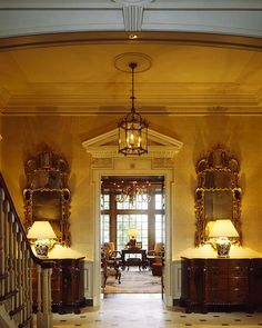 David Easton entry hall.  The symmetry of this entry ROCKS! Beautiful, I will love to use a Hypnotic Chandelier #bykoket