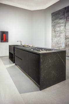 This all-grey space with the elegant Dekton kitchen island in color Kelya, combined with a few rarely color spots and mixed with silver details, gives a whole new meaning to #design in #kitchen.