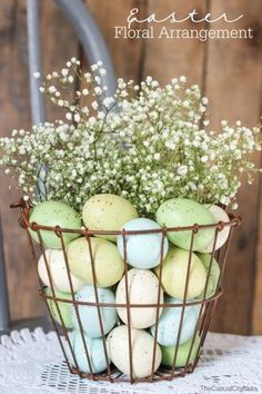 This Easter Floral Arrangement is so frugal with the low cost of baby's breath. More Spring & Easter Home Decor Ideas on Frugal Coupon Living.