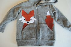 Look how the fox peeks out of the pocket!