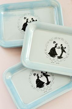 Vintage trays with silhouettes...LOVE