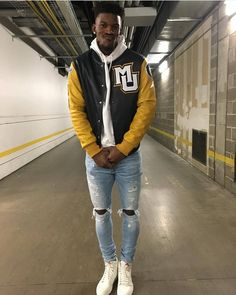 COLLEGIATE-INSPIRED... #Timberwolves baller #JimmyButler wearing  @paperbrownbagart #MarquetteUniversity jacket distressed jeans and #Nike sneakers.