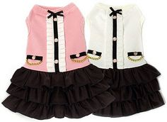 Coco Ruffle DogDress by Dogs of Glamour  Sophisticated, Timeless and Elegant! This little number has an assortment of details such as a soft cotton tank with ruffles, crystal button appliques, an ultra-soft neckline with a centered bow, and 3 cascading black tiered skirt. Be prepared for the compliments!  Colors: Pink or White  IMPORTANT SIZING INFO:  We have included an 'Approximate Weight' column, please do not   order based on weight only. Please take a moment