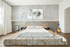 "Main Street Loft in Santa Monica, California, USA by SUBU Design Architecture - ""The bed was constructed out of 12' x 12' reclaimed logs anchored by two bent steel plates for side tables."""