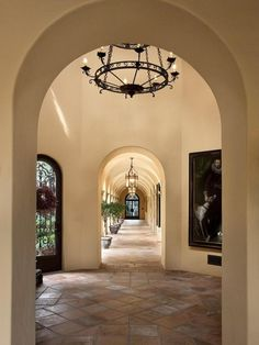 Mediterranean Hallway with Cathedral ceiling, Foyer Collection 9-Light Pendant, 16x16 Terra Cotta Sealed Super Saltillo Tile