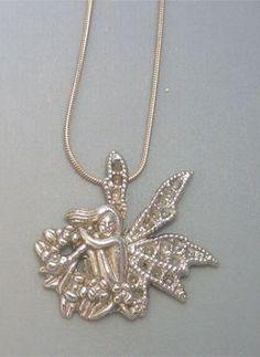 talismanes amuletos y símbolos   colgante hada jardín de plata