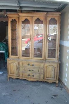 Before Pic of this French Provincial Hutch.