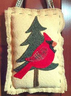 """Cardinal in a Pine Tree - """"The Quilted Crow Quilt Shop, folk art quilt fabric, quilt patterns, quilt kits, quilt blocks"""