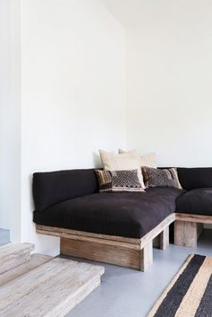 Black sofa in reading nook