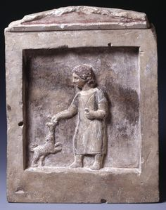 """Limestone stele of a young girl and a dog. This scene shows a small girl dressed in a long, unbelted peplos. The garment is textured with incised grooves, similar to those used to indicate the dog's fur."" - British Museum. The Girl is taunting the dog with something, possibly a bird. Alexandria, 2nd century BCE."