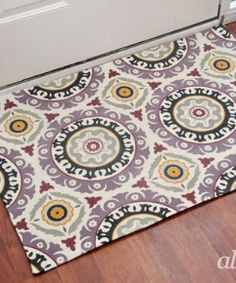 Make a rug out of any heavy weight fabric and a rubber mat! wow!!!