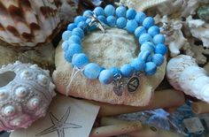 10mm Blue Frosted Agate beads and Silver Plated Starfish charm memory bracelet, $17.5