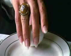 Fingers of Lou Cypher (played by Robert de Niro) in Angel Heart
