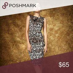 🎁24 hour SALE🎁New York & Company Jaquard Dress New York & Company Jaquard Dress size Large fits like a size 10. NWT beautiful dress! New York & Company Dresses Midi