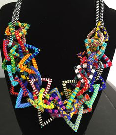 Nita E Kaufman - stacked another strand! Nita E Kaufman - stacked another strand! Fabric Jewelry, Beaded Jewelry, Beaded Necklaces, Jewellery, Peyote Patterns, Beading Patterns, Seed Bead Crafts, Bead Loom Bracelets, Ornaments