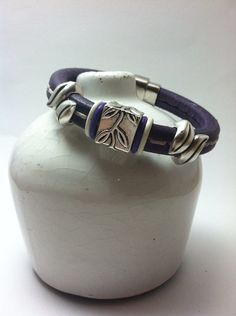 Purple stitched licorice leather bracelet with antiqued silver leaf accents on Etsy, $30.00