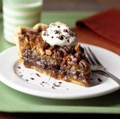 Millionaire's Pie: a gooey chocolate-pecan filling in a flaky piecrust. Recipe: http://www.midwestliving.com/recipe/pies/millionaire-pie