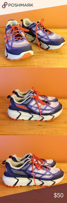 Hoka Challenger ATR Hoka One One Challenger ATR trail running shoe in size 9.5. Purple, gray, orange and silver. Super cushioned shoe. Tons of support. Excellent used condition. Worn a couple of times at work (walking and standing) with orthotics. Original, unused insole included. I have 2 pairs of these shoes. Price on listing in for one pair. Runs true to size, I just needed a size 10. No odor. Non-smoking home. No PP. NO TRADES!! Thank you. Hoka Shoes Athletic Shoes