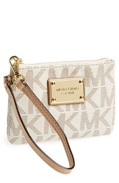 Free shipping and returns on MICHAEL Michael Kors 'Signature' Wristlet at Nordstrom.com. A gilt logo plate lends sophisticated polish to a Michael Kors wristlet with a compact cut to hold just the basics.