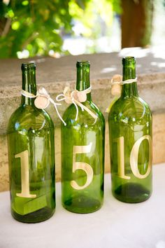 Wine bottle table numbers: http://www.stylemepretty.com/california-weddings/sonoma/2015/04/01/elegant-outdoor-wedding-2/ | Photography: Larissa Cleveland - http://www.larissacleveland.com/
