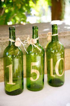 Wine bottle table numbers: http://www.stylemepretty.com/california-weddings/sonoma/2015/04/01/elegant-outdoor-wedding-2/ | Photography: Larissa Cleveland - http://www.larissacleveland.com/