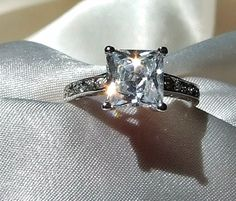 Vintage 3 Carat Square Princess-Cut Solitaire Diamond Alternative CZ Engagement Ring, Channel Set Pave Band, Sterling Silver This is the best ring I've seen. Dream Engagement Rings, Wedding Engagement, Wedding Rings, Solitaire Engagement, Pretty Rings, Beautiful Rings, Channel, Diamond Alternatives, Princess Cut Rings