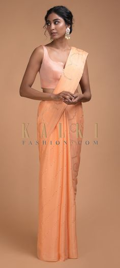 Buy Online from the link below. We ship worldwide (Free Shipping over US$100)  Click Anywhere to Tag Melon Peach Saree In Chiffon With Badla Work In Diagonal Stripes And Round Motifs Online - Kalki Fashion Melon peach saree in chiffon with badla work in diagonal stripes and round motifs.Trimmed with tassels on the pallu.