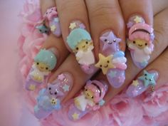 Little Twin Stars nail art. Probably would never have my nails done in this way, but I still think it's cute...and excessive.