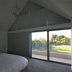 Bedroom with gable window. All blinds can be fully concealed inside the ceiling. Skylight Blinds, Blinds For Windows, Skylights, Window Blinds, Attic Master Bedroom, Bedroom Windows, Blinds And Curtains Living Room, Ceiling Curtains, Large Window Coverings