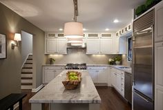Contemporary Kitchen with Undermount sink, Inset cabinets, Hardwood floors, Subway Tile, ILEX Baby T Wall Sconce, L-shaped