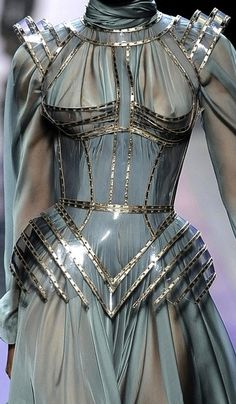 """Representation"" inspired by armor  Metal.  Jean Paul Gaultier Haute Couture, Fall 2009 - Dear Jean Paul Gaultier, please add lining to the boobage of your outfits - getting tired of seeing your models' nips."