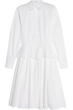 Givenchy's dress perfectly encapsulates Creative Director Riccardo Tisci's talent for mixing masculine and feminine elements. Tailored from breathable white cotton-poplin, this shirt-inspired style has a peplum ruffle at the waist and pleats through the skirt for volume. Wear it with simple heels or boy-borrowed flats.