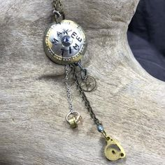 Handcrafted necklace made from vintage watch parts.