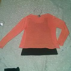 Eileen Fisher Light orange/Mellon colored Eileen Fisher sweater. Very cute in great condition! From shoulder to bottom of sweater is 22.5 inches. Lightweight sweater. Great with jeans and boots! Eileen Fisher Sweaters Crew & Scoop Necks