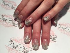 Lots of fun in this design. Titanium gel from Crystal nails was used through this entire design. Silver foil was placed randomly over the tip and mico fine glitter was used to fill in some gaps. Capped again with titanium buffed and top coat applied. Once the top coat was cured we painted the lines and dots using Royal gels to create a slightly 3D look