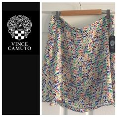 """Vince Camuto flare skirt New Vince Camuto azure sky flare skirt, size large.  18"""" long.  Beautiful silky fabric, hangs so nicely!  Zipper on side, fully lined. 100% polyester.  New with tag attached. Vince Camuto Skirts Mini"""