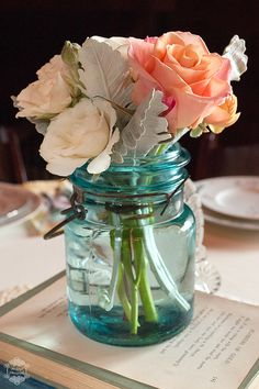 Vintage Wedding Tablescapes using blue mason jar & roses from Howell Family Farms Wedding - Blog - RENT MY DUST Vintage Rentals photo by Six Digit Photography. #vintagerentals #vintagewedding