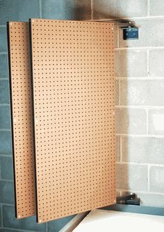 Double sided swinging peg board set up!  Less wall space more storeage!    Paint it, art, and useful!