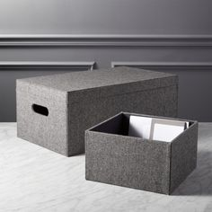 Shop tailor open storage boxes.  Storage suits up in a handsome diagonal stripe wool blend and double topstitched corners.