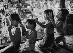 Mentawai, Indonesia  photo by Sebastião Salgado, 2008 http://melisaki.tumblr.com/post/764916026/mentawai-indonesia-photo-by-sebastiao-salgado# Sebastiao Salgado travels around the world taking pictures of third world countries. i like this picture because he captures children in an everyday act