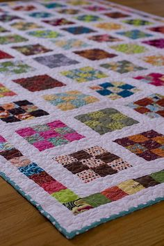 Nine Patch a Day Quilt Along Quilt - the border of the small squares really sets off this quilt