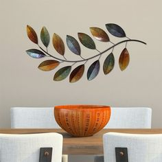 Bring a little personality to your living space! This charming #walldecor is made of metal with a branch and leaf design. Its leaf #accents have hand-painted amber rust and dark blue finishes for a captivating look. An attached keyhole makes hanging it easy and convenient. #wallart #wallsculpture #wallaccent #wallaccents #accents #designaccents #interiordesign #homedecor #interiors #designinspiration #art #artwork #decor #homedecorating #designideas #Zen #FengShui