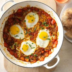 Shakshuka Recipe -Shakshuka is a dish of poached eggs with tomatoes, peppers and cumin. I learned it while traveling through Southeast Asia, and it's been my favorite way to eat eggs since. —Ezra Weeks, Calgary, Alberta