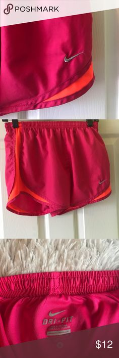 Nike Running Shorts Dry Fit These nike athletic shorts are perfect for working out or just casual lounging and wear! They are worn, but are still in good condition. The shorts are bright in color and perfect for summer. They are a size small and run true to size. Please feel free to leave questions and make offers! Nike Shorts