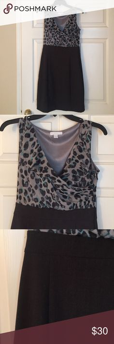Dress Animal print dress. Only worn once. Elastic waistband.  Bottom is dark grey.  Side zipper.  Slit in middle of back of skirt.  Bodice is 100% polyester.  Skirt is 65% polyester 31% rayon 4% spandex. New York & Company Dresses Mini