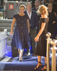 Zara Phillips, 35, cut an elegant figure in a navy frock, as she led the stylish arrivals at the Magic Millions launch party in Surfer's Paradise, Queensland, on Tuesday.