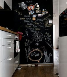 9 ways to use a chalkboard wall: Use magnetic chalkboard paint to stick up photos and make doodles.