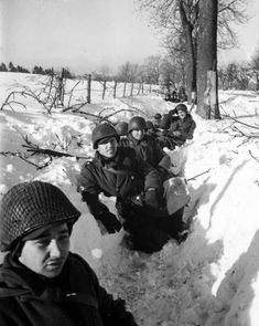 American soldiers holding the front line in Bastogne, during the Battle of the Bulge.